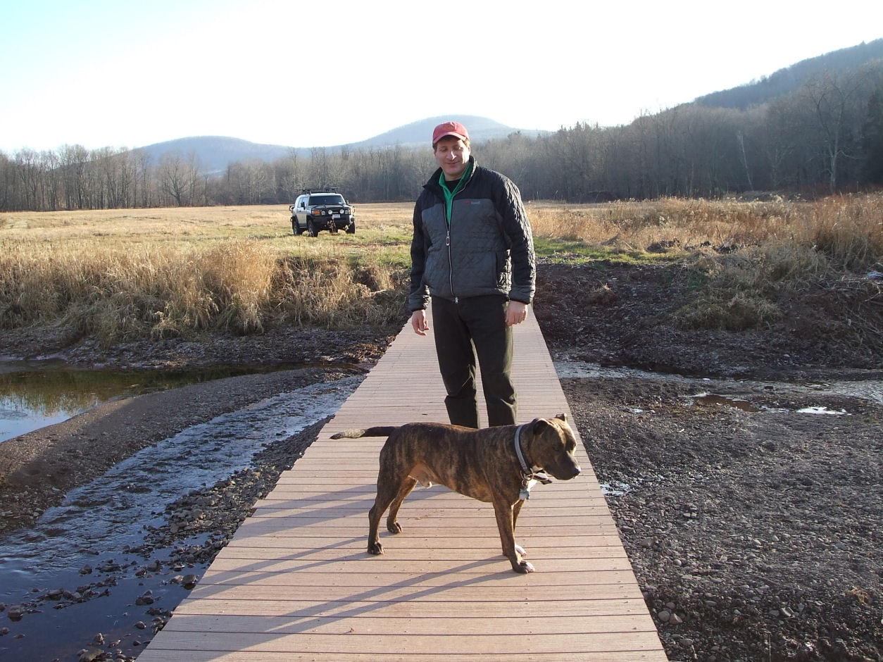 Nick Bove and mascot Ritalin on one of the five newly-constructed bridges.